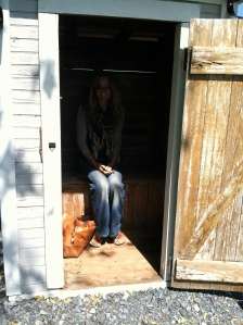 I am sitting with dignity on a 100 year old outhouse toilet (not actually in use)