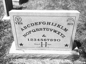 "The Ouija board layout is carved on the back Elijah Jefferson Bond's gravestone, who invented and then patented it in 1891. ""Talking board"" expert Robert Murch found Bond's unmarked grave and commissioned the grave marker in 2007."