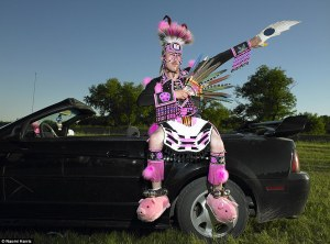 A Sioux Indian in an unusual attire complete with pink pig-shaped slippers attends a Valley Pow Wow in Sioux Valley, Manitoba