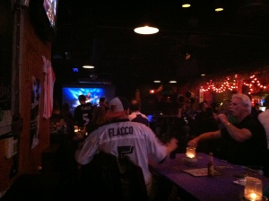 A testosterone-filled bar of football fans. So many screens in so many bars!