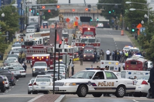 Police and firefighters respond to the report of shooting at the Navy Yard in Washington, D.C
