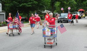 Mary Kay walking with Food for Tomorrow on 4th July