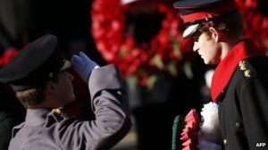 Prince Harry lays a wreath on behalf of his father