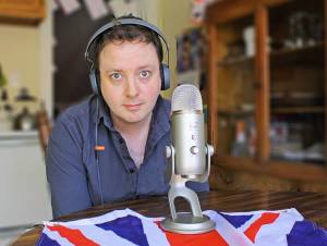 Laurence doing his podcast