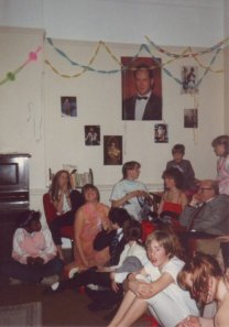 British school girls in a boarding school common room (can you spot me?!). Note Bruce Willis on the wall!